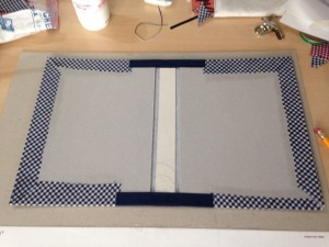 Gluing fabric on the paperboard